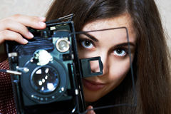 Young girl and old camera Royalty Free Stock Photo