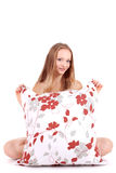 Young girl with big pillow Stock Images