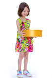 Young girl with big round box. Royalty Free Stock Photos