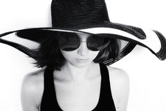 Young girl in a big round sunglasses and summer hat Stock Photos
