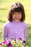 Young Girl Big Smile. An adorable young Hispanic American girl in the 5-8 year old range. She is wearing a pink purple turtleneck shirt and has a wonderful big Stock Image