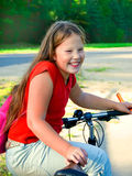 Young girl and bike royalty free stock photography