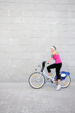 Young girl on a bike Stock Images