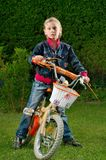 Young girl and bike Royalty Free Stock Image