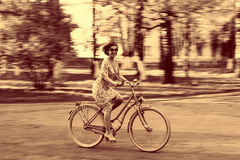 Young girl on bike in movement Royalty Free Stock Photo