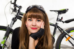 The young girl with bike. Stock Images