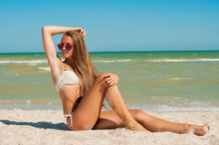 Young girl in a bikini on the beach Royalty Free Stock Images