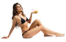 Young girl in bikini with coctail Royalty Free Stock Image