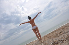 Young girl in a bikini looking at sea Stock Photo