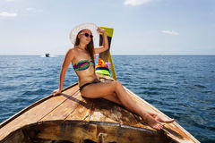 Young girl in bikini sitting on Thai boat Royalty Free Stock Photos