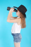 Young girl with binoculars stock photo
