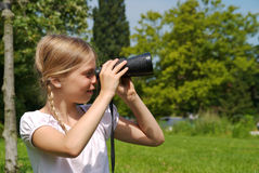 Young girl with binoculars outside Stock Photos