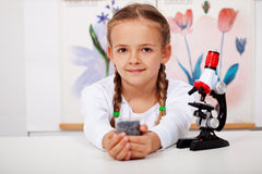 Young girl in biology class Royalty Free Stock Photography