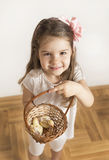Young girl and bird like friends full of love. Little girl holding basket with baby parrots in it Royalty Free Stock Image
