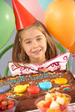 Young girl with birthday cake at party Royalty Free Stock Photo