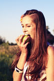 Young girl bite apple Royalty Free Stock Image