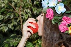 Young girl biting an apple Royalty Free Stock Photos