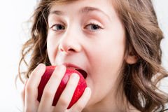 Young girl biting into apple Royalty Free Stock Images