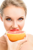 Young girl biting a juicy Royalty Free Stock Images