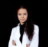 Young girl on a black background Stock Photography