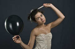 Young girl with black balloons Stock Photos