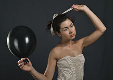 Young girl with black balloons Stock Photo