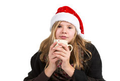 Young girl with black cape and red winter cap holding cup. Isolated on white background Stock Image