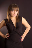 Young girl in a black dress. Against a background Royalty Free Stock Image