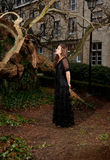 Young girl in a black dress in the park Royalty Free Stock Photo