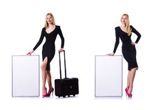 Young girl in black dress with poster and valise isolated on whi Royalty Free Stock Photos