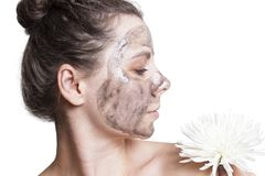 Young girl with black facial mask for face care isolated on white background. Skincare concept. royalty free stock image