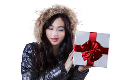 Young girl in black jacket holds presents Royalty Free Stock Photos
