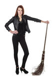 Young girl in black leather jacket holding wicked broom isolated Stock Photos