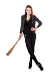 Young girl in black leather jacket holding wooden club isolated Stock Photo