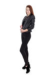 Young girl in black leather jacket isolated over white Royalty Free Stock Photography
