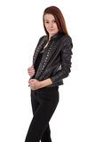 Young girl in black leather jacket isolated over white Stock Photos