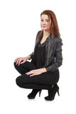 Young girl in black leather jacket isolated over white Stock Photo