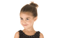 Young girl in black leotard smiling head turned Stock Images
