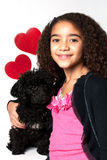 Young girl with black poodle Stock Photography