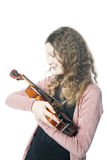 Young girl with blond curly hair holds violin in studio. With white background Royalty Free Stock Photos