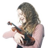 Young girl with blond curly hair holds violin in studio Royalty Free Stock Photo