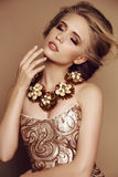 Young girl with blond hair and bright makeup with accessories Royalty Free Stock Images