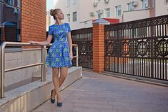 Young girl blonde in blue short dress Royalty Free Stock Images