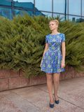 Young girl blonde in blue short dress Royalty Free Stock Photos