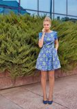 Young girl blonde in blue short dress Stock Photography