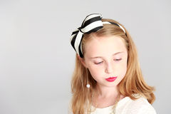 Young girl blonde girl with with bow in hair Royalty Free Stock Photography