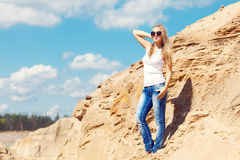Young girl the blonde in jeans Stock Image