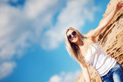 Young girl the blonde in jeans Royalty Free Stock Photo
