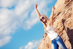 Young girl the blonde in jeans Stock Images