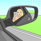 A young girl, a blonde is making a selfie photo in the mirror of a side view of a car. Vector. Illustration Stock Photos